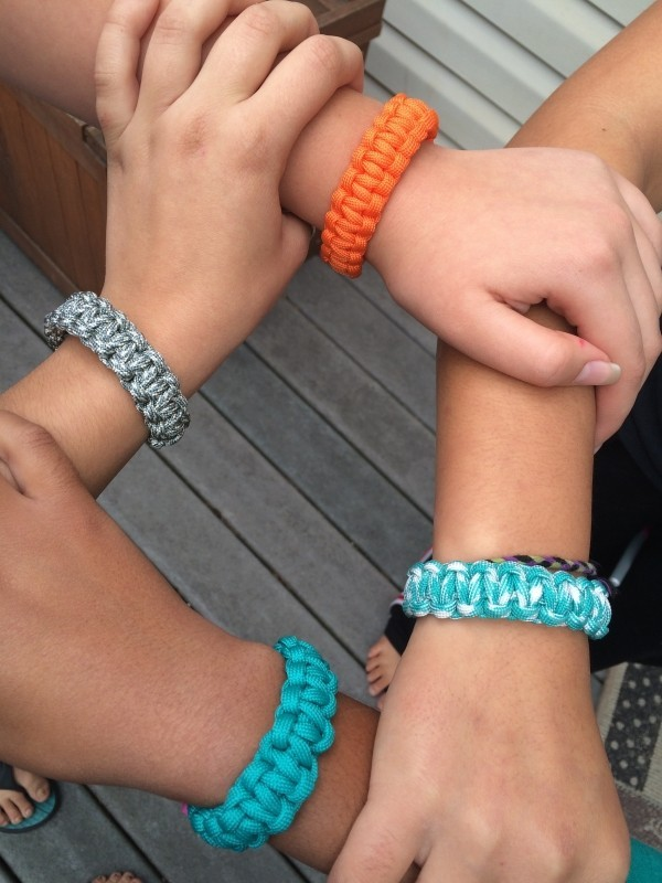hands-square-bracelets-people-women-work-team.jpg